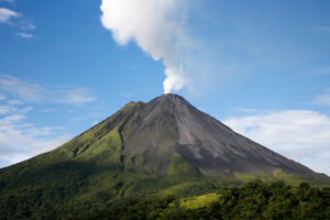 Arenal volcano in costa rica with a plume of smoke